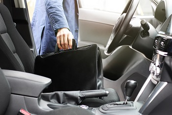 Businessman Taking Briefcase Our Of Car